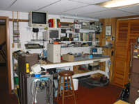 A wide electronics workbench about sever feet long which provides an anti-static environment for repairing computers and other electronics using common electronic test equipment and small hand tools.